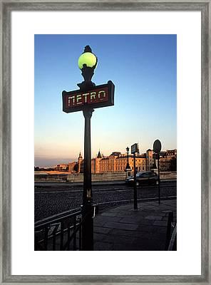 Le Metro At Dusk Framed Print by Kathy Yates