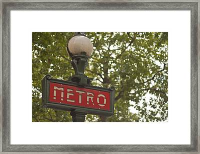 Le Metro Framed Print by Georgia Fowler