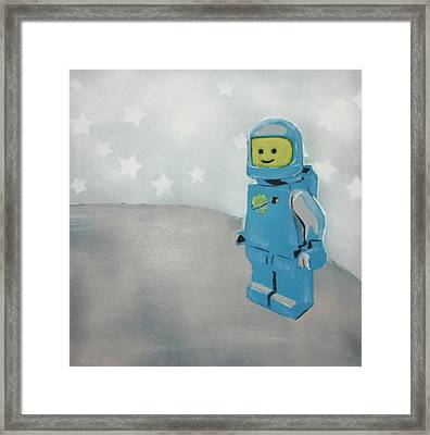 Lego Man On The Moon Framed Print by Wall Kandi