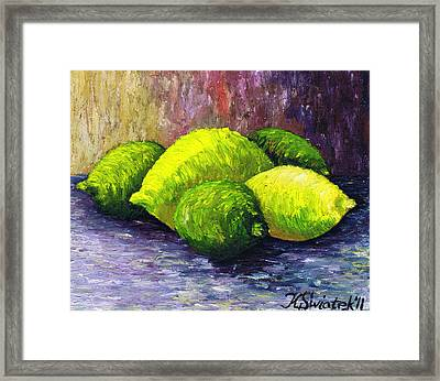 Lemons And Limes Framed Print by Kamil Swiatek