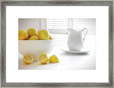 Lemons In Large Bowl On Table Framed Print by Sandra Cunningham