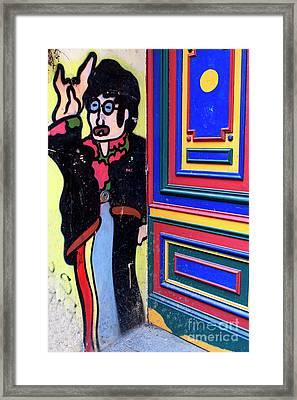 Lennon In Berlin Framed Print by John Rizzuto