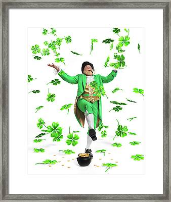 Leprechaun Tossing Shamrock Leaves Up In The Air Framed Print by Oleksiy Maksymenko