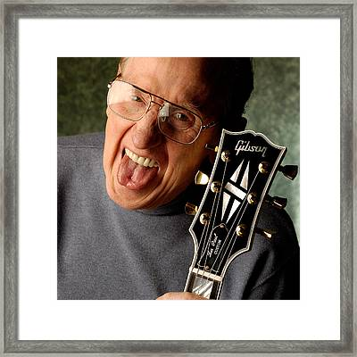 Les Paul With Tongue Out By Gene Martin Framed Print