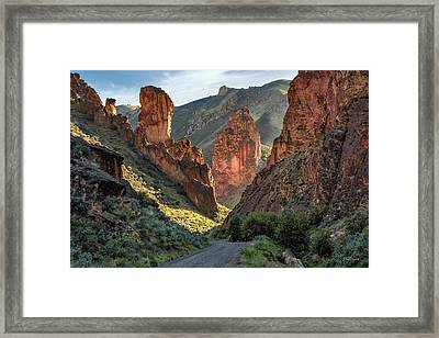 Leslie Gulch Road Framed Print by Leland D Howard