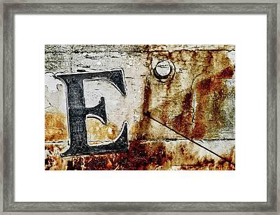 Letter E In The Rust Framed Print