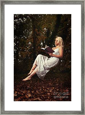 Levitation With Book Framed Print