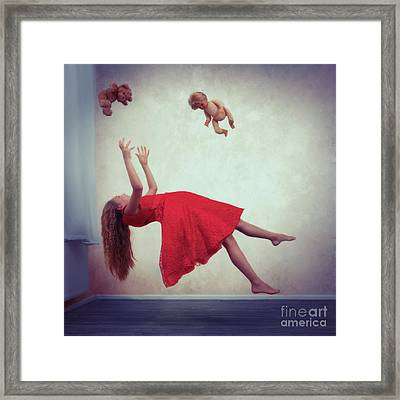 Levitation With Toys Framed Print