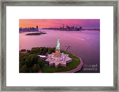 Liberty Island Twilight Framed Print by Inge Johnsson