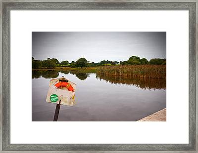 Lifebelt And Sign For The Samaritans Framed Print by Panoramic Images