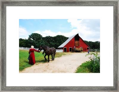 Lifting Hay Framed Print