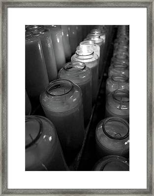 Light A Candle Framed Print