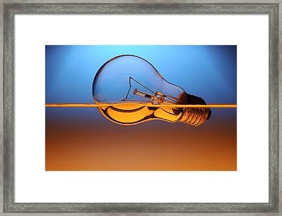 Light Bulb In Water Framed Print by Setsiri Silapasuwanchai