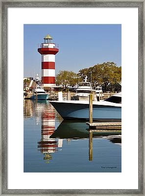 Light In The Harbor Framed Print