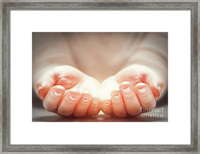 Light In Woman's Hands. Concepts Of Sharing, Giving, New Life Framed Print