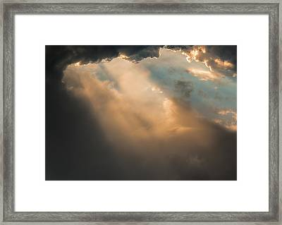 Light Punches Through Darkness Framed Print