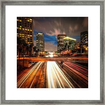 Light Trails On Road Framed Print by Neil Kremer