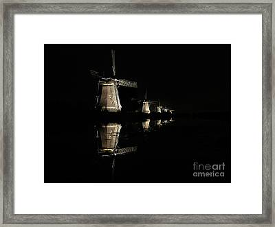Lighted Windmills In The Black Night Framed Print