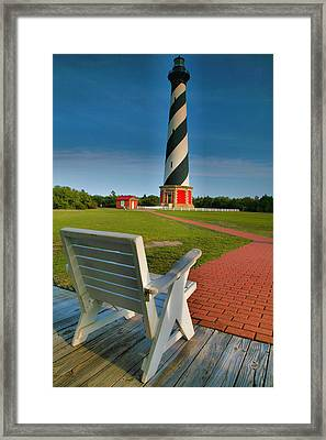 Lighthouse And Chair Framed Print by Steven Ainsworth