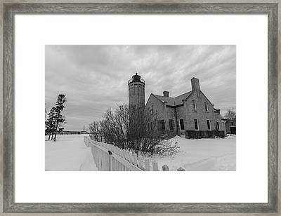 Framed Print featuring the photograph Lighthouse And Mackinac Bridge Winter Black And White  by John McGraw