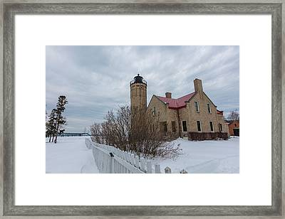 Framed Print featuring the photograph Lighthouse And Mackinac Bridge Winter by John McGraw
