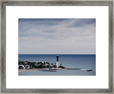 Lighthouse And Rain Clouds Framed Print