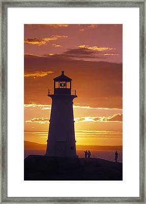 Lighthouse At Sunset In Peggys Cove Framed Print by Richard Nowitz