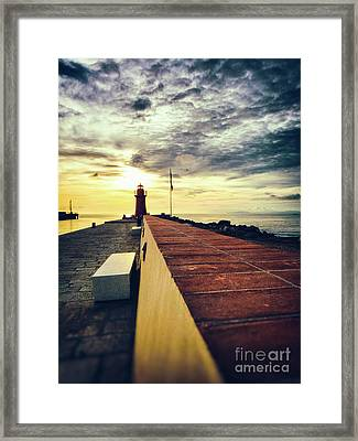 Framed Print featuring the photograph Lighthouse At Sunset by Silvia Ganora