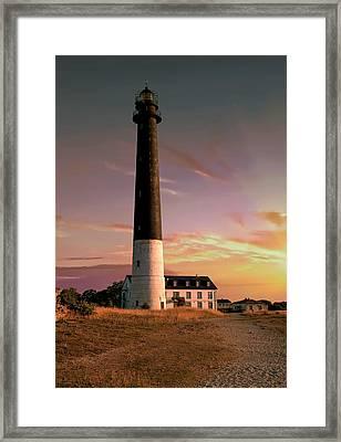 Lighthouse At The Sunset Framed Print