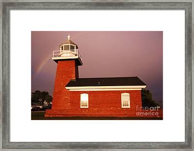 Lighthouse In A Rainbow Framed Print
