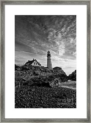 Lighthouse In Black And White Framed Print by David Bishop