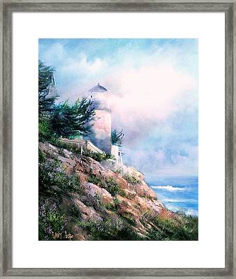 Lighthouse In The Mist Framed Print by Sally Seago