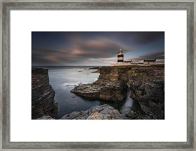 Lighthouse On Cliffs Framed Print