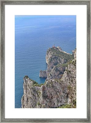 Lighthouse On The Cliff Framed Print