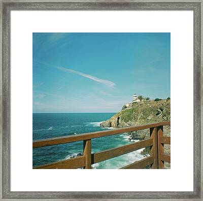 Lighthouse Over The Ocean Framed Print