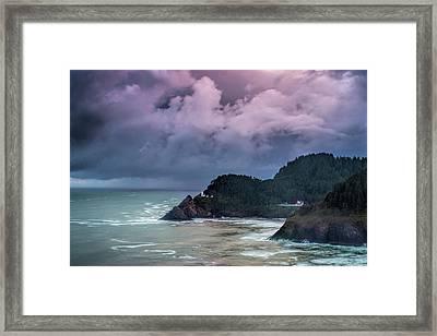 Lighthouse Over The Rugged Coast Framed Print