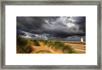 Lighthouse Rainbow Framed Print by Adrian Evans