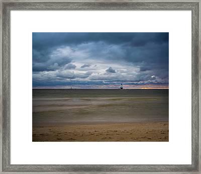 Lighthouse Under Brewing Clouds Framed Print