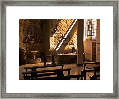 Framed Print featuring the photograph Lighting Candles by Ron Dubin