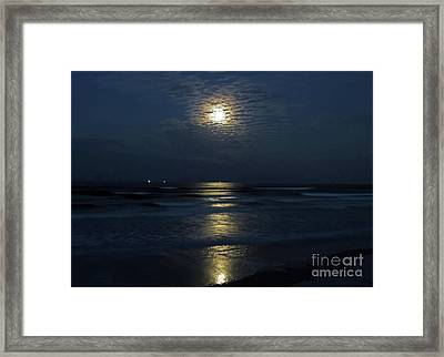 Lighting Up The Surf Framed Print by D Hackett