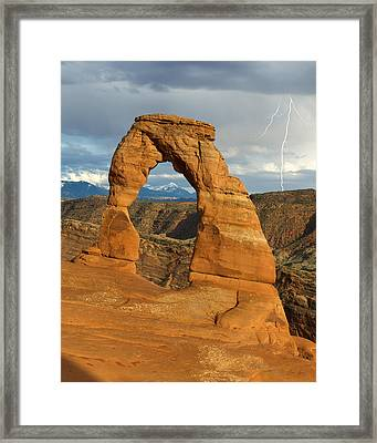 Lightning At Delicate Arch Vertical Framed Print by Aaron Spong