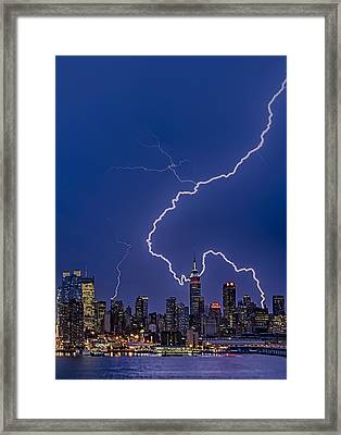 Lightning Bolts Over New York City Framed Print by Susan Candelario