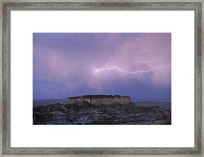 Lightning Strikes Above A Butte Framed Print by Joel Sartore