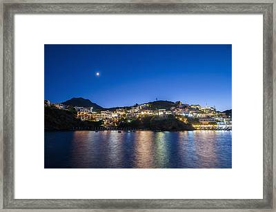 Lights Illuminate The City And Reflect Framed Print by Dosfotos
