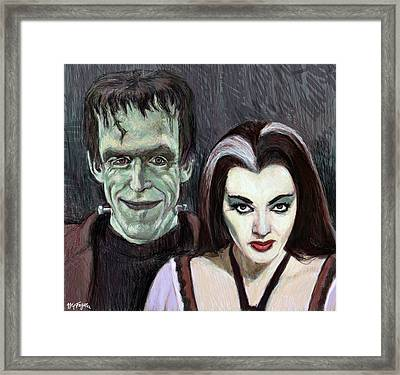 Lily And Herman Munster Framed Print by Neil Feigeles