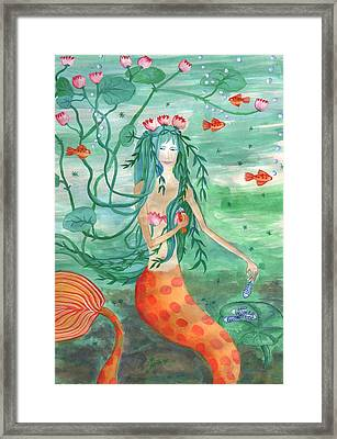 Lily Pond Mermaid With Goldfish Snack Framed Print by Sushila Burgess