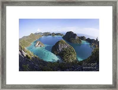 Limestone Islands Surround A Lagoon Framed Print by Ethan Daniels