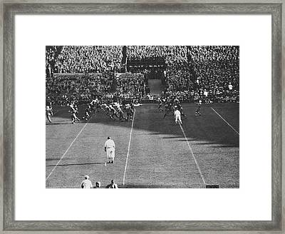Lineman Tips Pass Framed Print by Underwood Archives