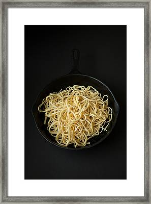 Linguine In A Cast Iron Pan With Black Background Framed Print by Erin Cadigan
