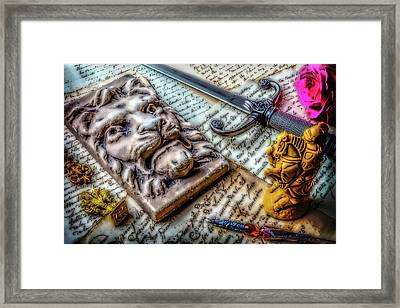 Lion And Dagger Framed Print by Garry Gay